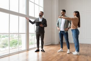 Estate Agent Showing Prospective Buyers Around Property